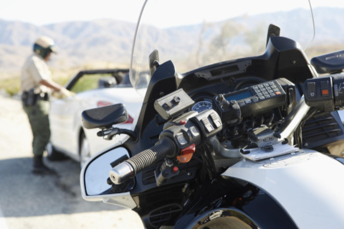Police stopping vehicle on highway: Lorenzo & Lorenzo Auto & Motorcycle Accidents Blog