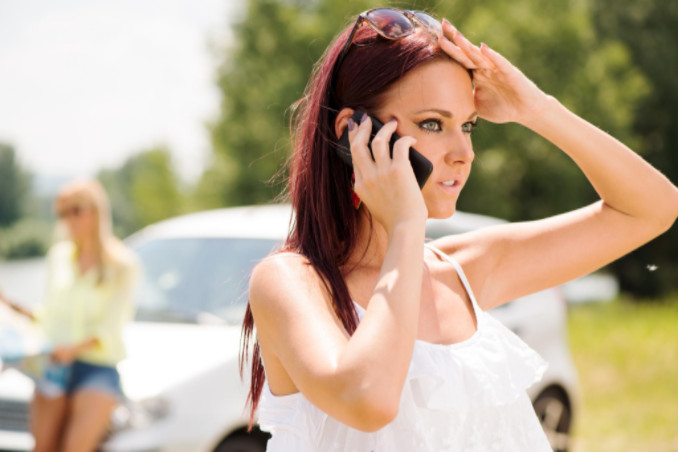 Woman using cell phone after accident: Lorenzo & Lorenzo Personal Injury Guide