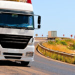 Semi-truck driving around curve: Lorenzo Truck Accidents Blog
