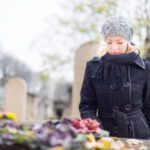 Woman in black visiting grave: Lorenzo & Lorenzo Wrongful Death Blog