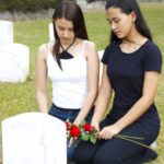 two women grieving at tombstone: Lorenzo and Lorenzo Wrongful Death blog