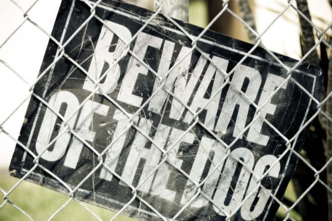 Fence with beware of dog sign: Lorenzo Premises Liability Knowledge Center