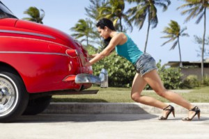 young woman pulling car