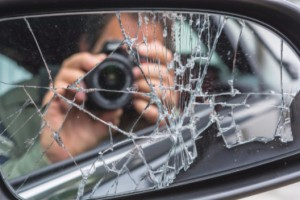 man taking pictures after accident